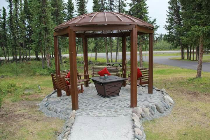 Gazeebo with satellite dish cover and bench swings