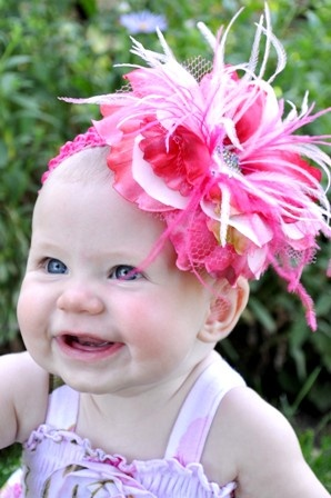 This site has a lot of cute baby girl stuff!  I am totally shopping here, or atleast get ideas for making them