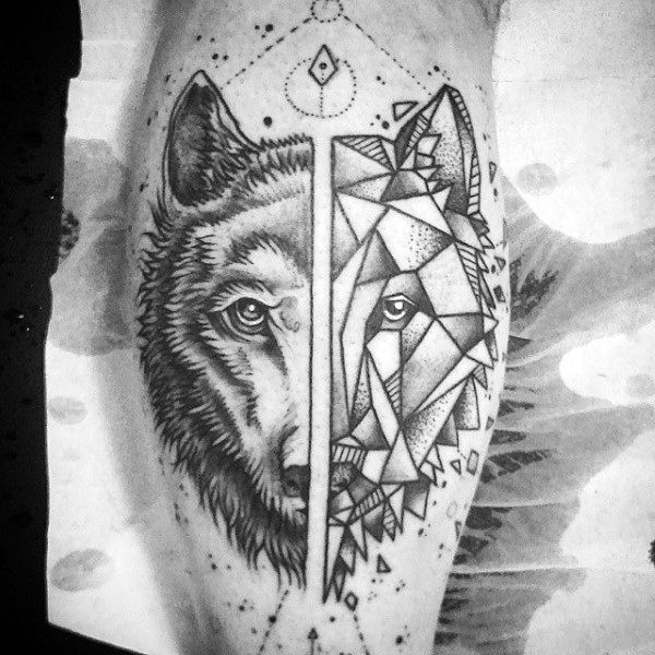 Guy With Geometric Wolf Leg Calf Tattoo