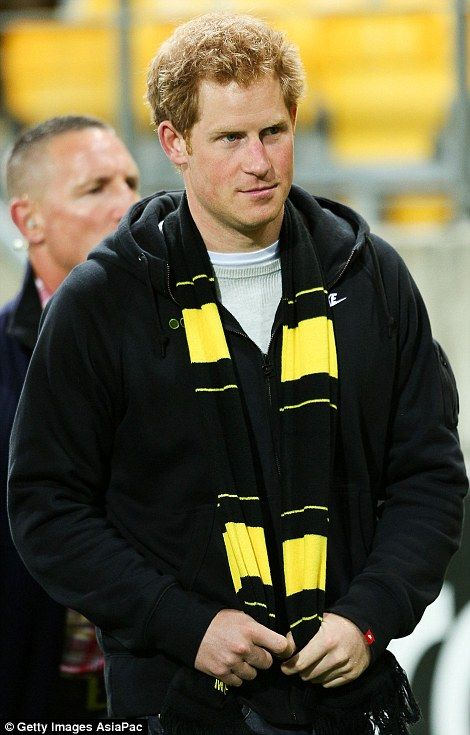 Prince Harry wears the colours ofthe Wellington Hurricanesafter watching the round 13 Super Rugby match between the Hurricanes and the Sha...