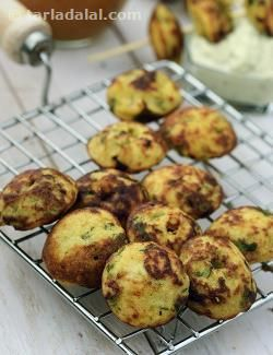 A wholesome batter of four dals and rice is fermented overnight. The next day it is reinforced with flavourful ingredients like spinach, onions, and so on, and cooked in an appe mould to make a tasty snack that goes wonderfully well with sambhar and chutney. You can have this is a satiating evening snack with coffee or tea, or serve it as a starter at parties, but ensure that you serve it immediately on preparation as it becomes rubbery and loses its flavour after some time.