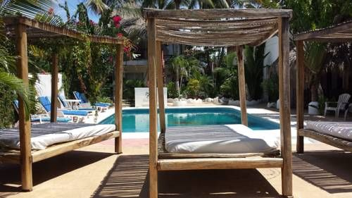 Nuestra Casa-Sai Pet Friendly Hotel & Beach Club Acapulco Offering an outdoor swimming pool, a special pool for pets, tropical gardens and a beach club can be found at this small hotel, located just 80 metres from Pie de la Cuesta Beach. The air-conditioned rooms include free Wi-Fi.