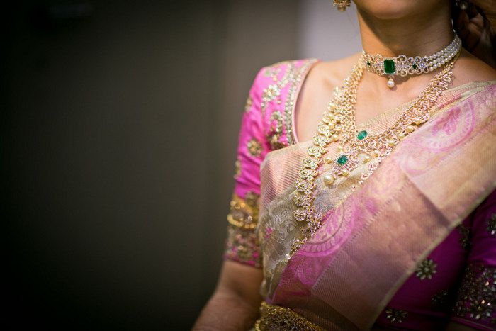 So many pretty Kanjivarams in a row in this wedding- right from the kaleidoscope of color on the bridesmaids to the elegant  blush pink and gold the bride wore that is just glistening in the light ...