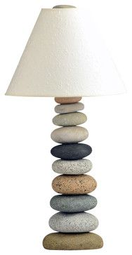 Whimsical beach-inspired lamp. This lamp cairn was made by selecting and stacking stones from the beaches of New England and is for purchase. But with the right craftiness, this lamp can serve as inspiration for a DIY version with beach, river or lake rocks.