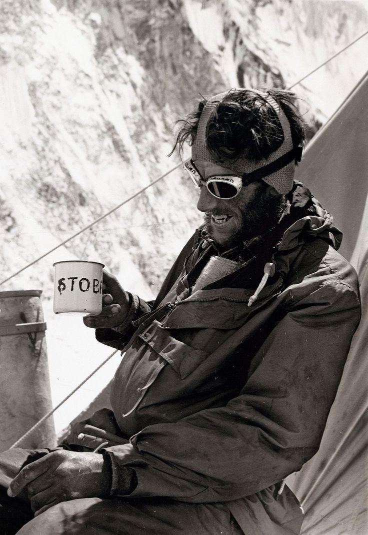 Sir Edmund Hillary drinks a celebratory cup of tea at Camp IV, surrounded by the relative comforts of a high-altitude campsite after his and Tenzing Norgay's successful ascent.
