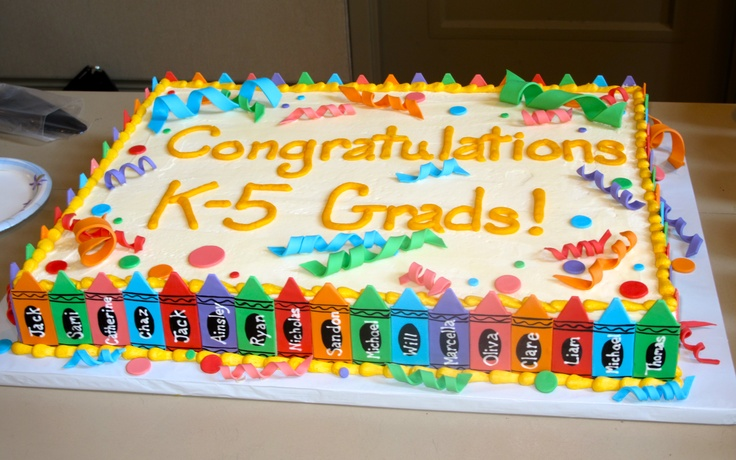 Crayon Cake - Made for a kindergarten graduation.  White buttermilk cake with vanilla/almond buttercream.  Decorations made with 50/50 fondant/gum paste mixture, black food gel and royal icing.