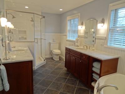 Marble Tile In The Shower, Heated Floor, His And Hers Bathroom Vanities,  Corner Tub