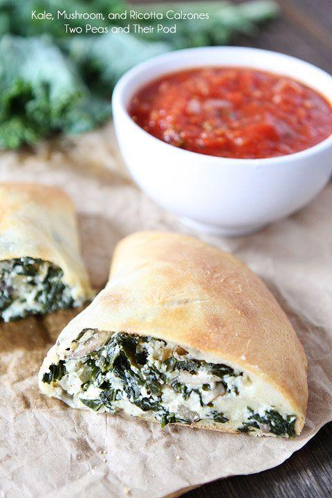 Kale, Mushroom, and Ricotta Calzones Recipe on twopeasandtheirpod.com Love these cheesy veggie stuffed calzones!