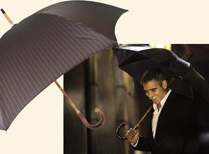 George Clooney stylish as always with a Pasotti one-piece chestnut umbrella in the Nespresso commercial (2013)  #GeorgeClooney #Pasotti #Nespresso #RosinaPerfumery
