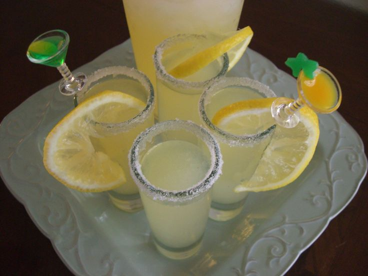 Lemon Drop Shots-12 ounces, weight Can Frozen Lemonade Concentrate 2 ounces, fluid Bacardi Limon Rum 1 ounce, fluid Absolut Citron Vodka 4 whole Lemons (small), Divided 3 Tablespoons Sugar, Divided 1 cup Ice, Crushed
