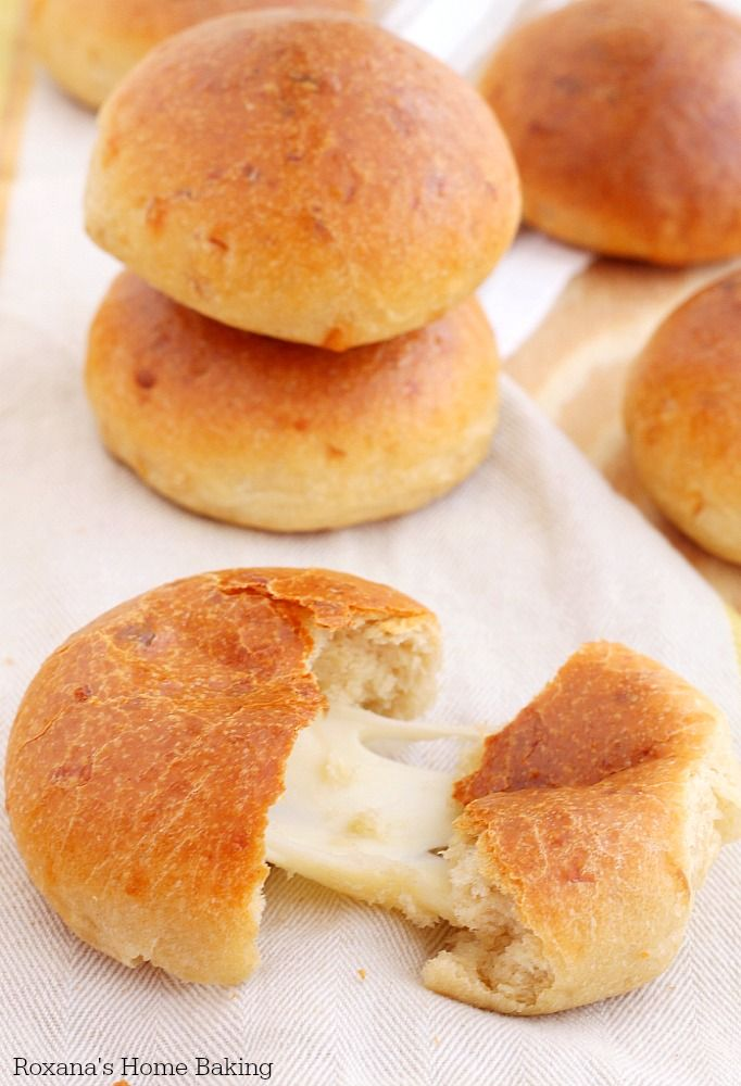 Soft homemade cheese dinner rolls made with three types of cheese and filled…
