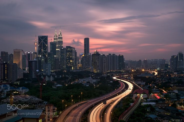 Bright Lights and Big Cities - Pinned by Mak Khalaf A 12 hour layer over Kuala Lumpur found me at this spot during sunset hour. City and Architecture sunsetlightbeautifulhappyfunasiamoodyhighnighttimelight trailstrailskuala lumpurfujifilmblue hourexploreNightNightscapeCityCityscapeKULX-T2 by RyanBentley