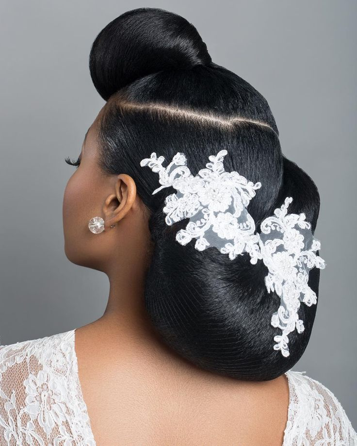 Her very thick Afro hair was 'patiently' blow dried and in two sections, I created a big 'moon shape' bun at the back and a 'cone' bun with the front...