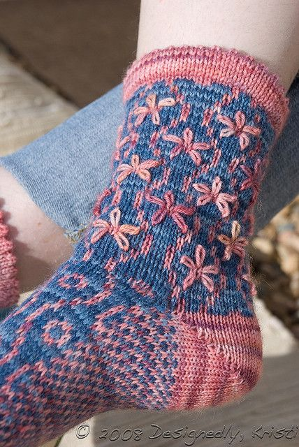 Ravelry: Longbourn Socks pattern by Kristi Schueler. Lazy Daisies are embroidered to complement the sock pattern.