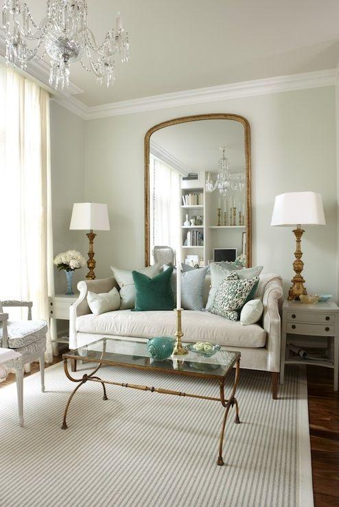Sarah Richardson Design Light Green Walls Paint Color Floor Length Gold Mirror Nicole Sofa With Pillows Antique Brass Glass Top