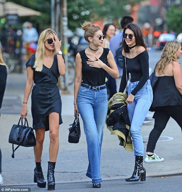 Added extras: The 21-year-old wore flared jeans with a raw edge and added a Hermes belt, Ray Ban sunglasses and a pair of black mules