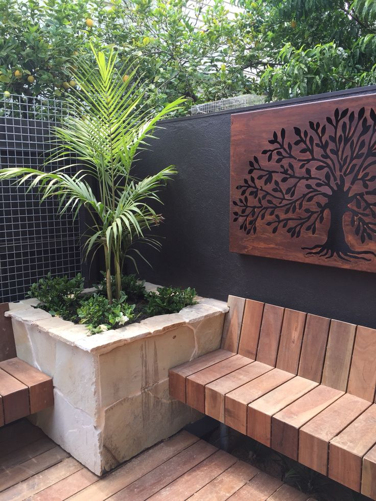 A lovely built in planter box clad in random sandstone. www.rpgardendesign.com.au