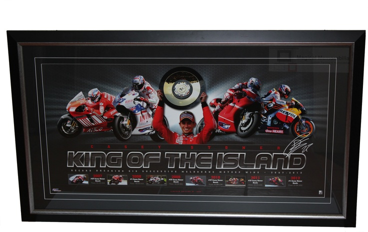 """Casey Stoner """"King of the Island"""" celebration sports print celebrates Casey's consecutive wins on the Island. Each print is complete with a printed (facsimile) signature. Features facsimile signature of Casey Stoner Licensed Product Accompanied with a Certificate of Authenticity LImited in edition to 1000 only Features the statistics and images of Casey's Phillip Island Moto GP Wins"""