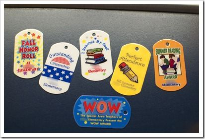 Every student in the school gets brag tags. They all start the year out with a grade level tag. As the year goes on, they can earn lots of different tags. There are some for reading, honor roll, attendance, field day, variety show, summer reading, birthday, etc. TONS! And the kids LOVE to collect! You can order from: http://www.imagestuff.com/