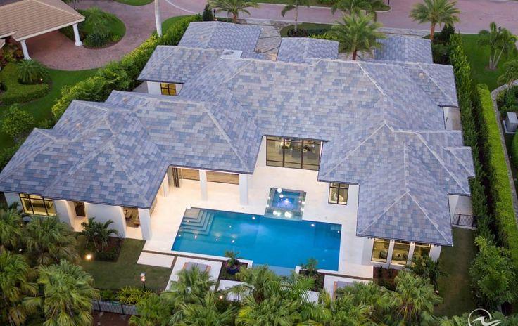 Golf course new construction estate home in pelican bay
