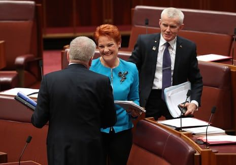 Communications minister Mitch Fifield congratulates Pauline Hanson and Malcolm Roberts the media reforms passed with their help.