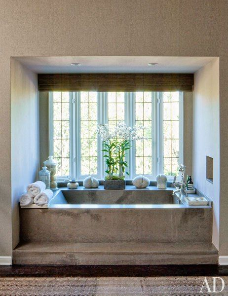 Stone Bathtub in a windowed alcove. Hollywood Powerhouse Sandy Gallin Shifts His Talents to Interior Design