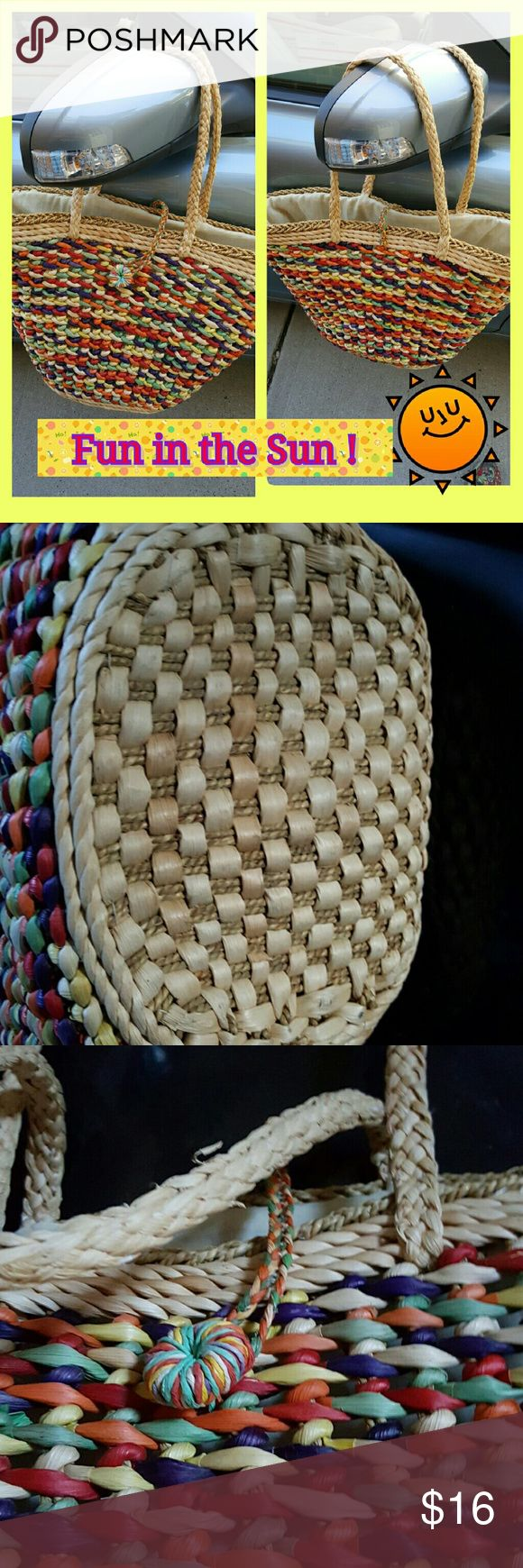 Amazing Straw Beach bag Seriously like new. Lines and cotton with side zipper pocket. Approximately 21 inches at its widest, 12 up and down common on across the bottom with a 9 inch drop Bourique Bags