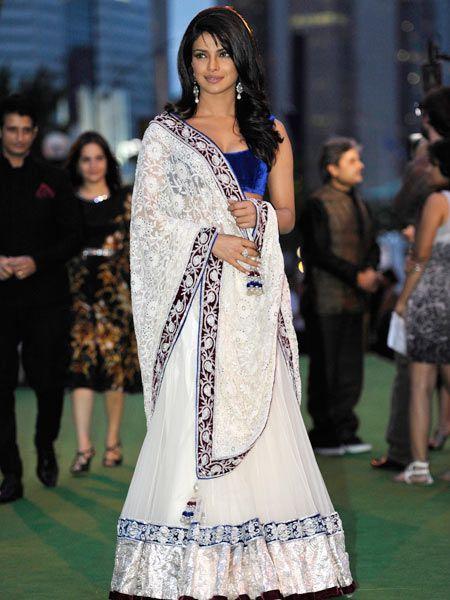 Priyanka looks so pretty! I love her lehenga. Simple and elegant!