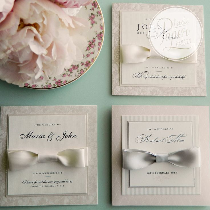 a range of beautiful invites with layers of patterned and textured paper and finished with a satin bow.