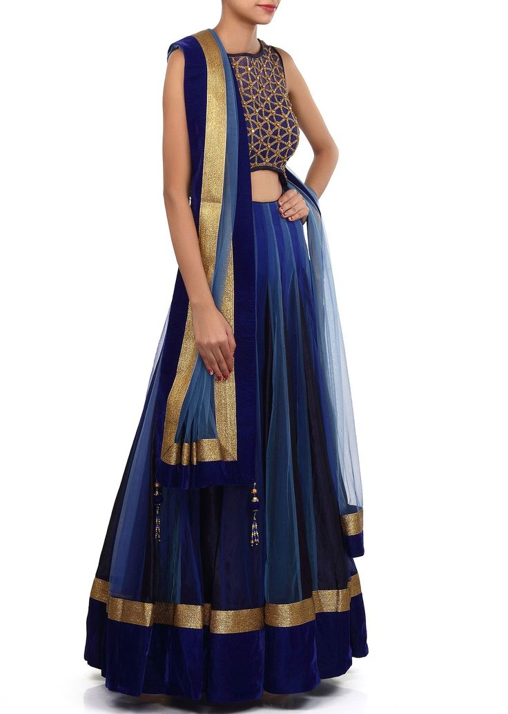 This lehenga choli is made in shaded blue net fabric. Blouse of this lehenga choli is weaved in kundan and zardosi weaving and improved in waist line cut work. Dupatta of this lehenga choli is in net