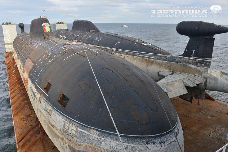 Biggest Russian submarine on a boat going thru Arctics