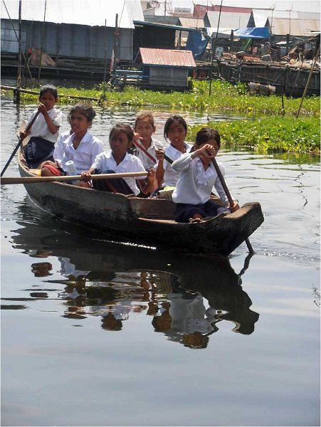 Children heading to school, Tonle Sap River, Siem Reap, Cambodia
