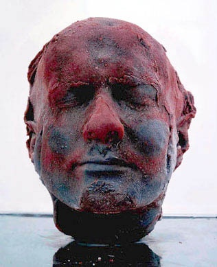 Marc Quinn self sculpture, made with his own blood and frozen at a specific temperature. reminds viewers how precious life is