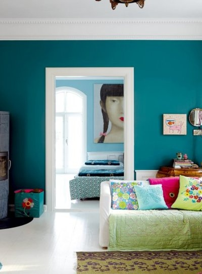 I love the contrast of dark teal in the living room and the lighter blue in the bedroom. But I also love the oversized portrait.