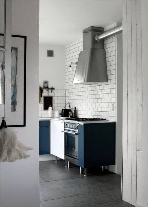ILVE Nostalgie Range in Matte Graphite - loving this industrial style space warmed up with navy blue cabinets.