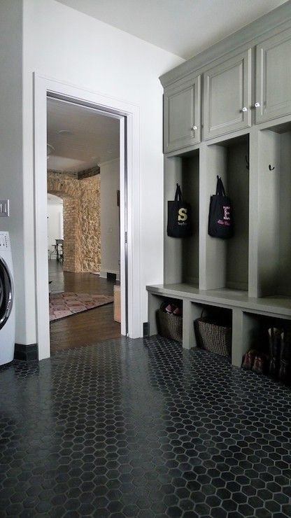 gray mudroom lockers; black hex travertine floor