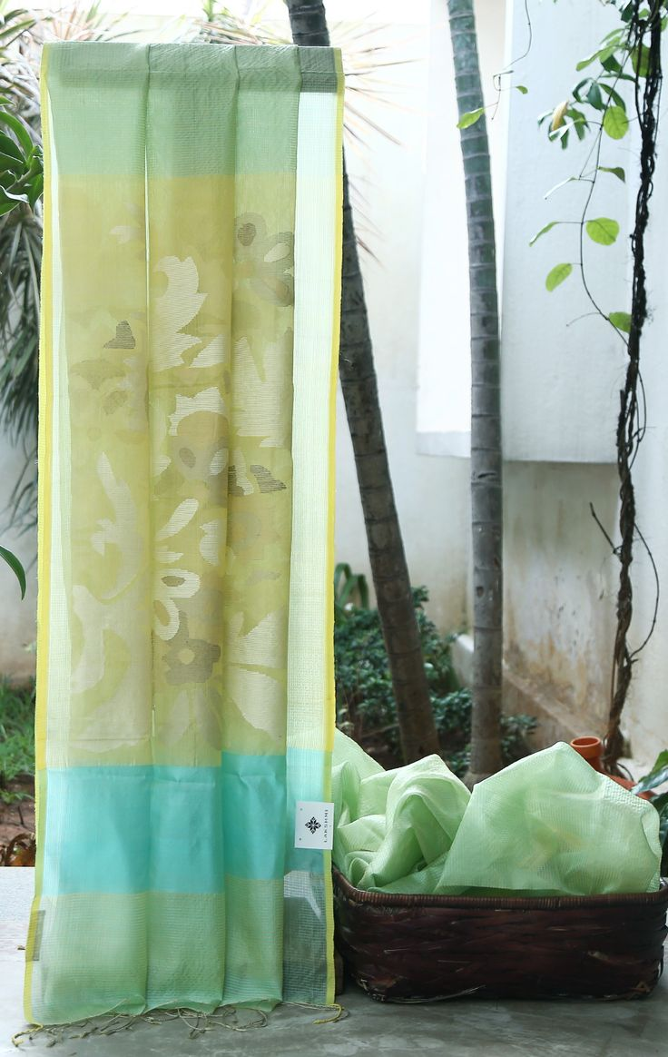 RADIANT SKY BLUE IRIDESCENT LIME YELLOW WITH HORIZONTAL STRIPES HAS KORA PALLU WITH INTRICATE JAMDANI FLORAL WEAVE WHICH GIVES THE SAREE BEWITCHING FINISH.
