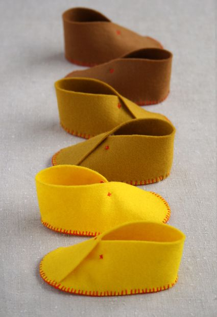 cutest lil' baby shoes and looks super easy to make...http://www.purlbee.com/felt-baby-shoes/