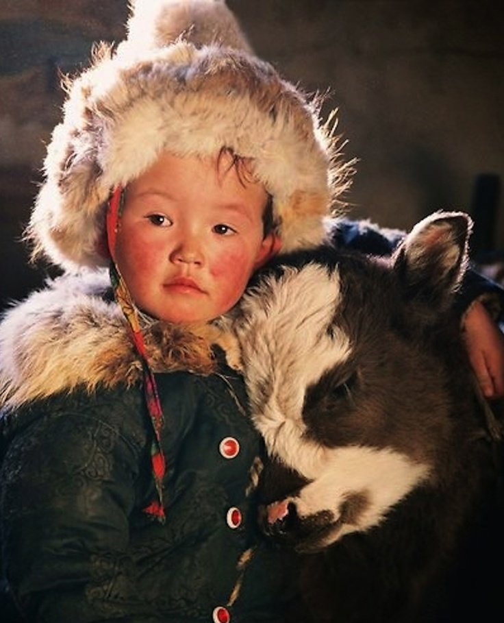 Tibetan boy and his calf.
