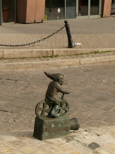 Dwarf on a Bicycle - Wroclaw, Poland;  one of fifty or so dwarf statues around town;  photo by mathias.b, via Panoramio