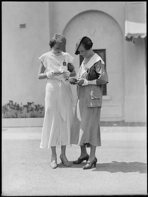 Two women racegoers at Warwick Farm racecourse, 1934.