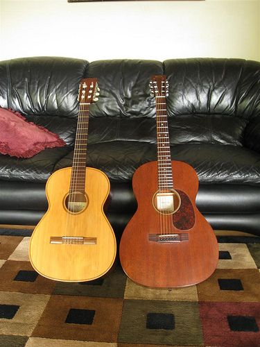 On the left, the guitar I learned to play on - a 1972 Douglas classical that my mom bought in college, which became mine. On the right, a 2004 Martin 000-15s that I just got.   guitarra guitarrista guitarras hacer musica pentatonica