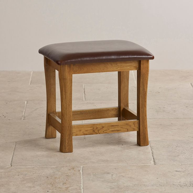 A modern classic, the Orrick Leather Dressing Table Stool is crafted in solid hardwood and finished in a warm rustic finish.