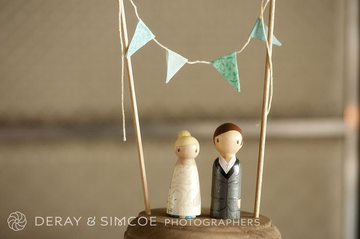 Blue and green bunting with hand painted bride and groom cake toppers