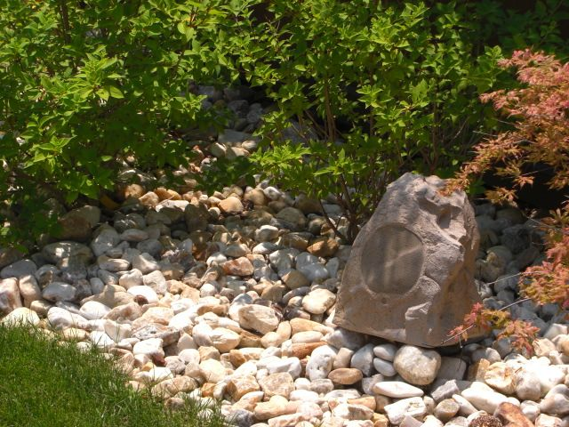 these dont exactly disappear unless we plan to landscape with boulders. outdoor rock speakers