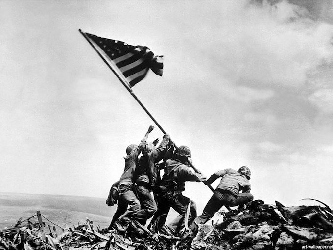 Joe Rosenthal's picture of the Raising of the Flag in Iwo Jima. The photo is the most iconic picture of World War II.