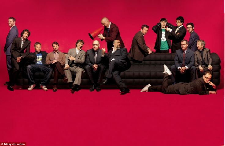 From left to right: Dave Gorman, Chris Addison, Russell Howard, David Mitchell, John Bishop, Dara O'Briain, Al Murray, Omid Djalili, Lee Mack, Tom Deacon, Simon Bird, Jack Dee, Mark Watson, Frank Skinner, Alan Carr. I don't know why these guys are together I don't care.