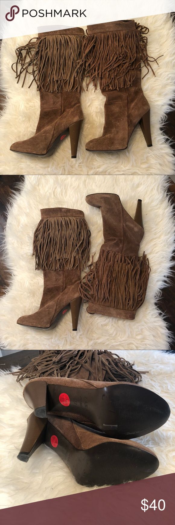 Festival Ready Suede Fringe Zara Boot Super cool brown suede Zara boots with boho fringe.  Gently used condition.  Few knicks on heel. Made in Spain. These boots are awesome. size 37 Euro.  Approx 9.5 inches heel to toe length.  4 inch heel height.   Bundles and offers welcome.  All orders ship within 24 hours unless the weekend then Monday am. Zara Shoes Heeled Boots