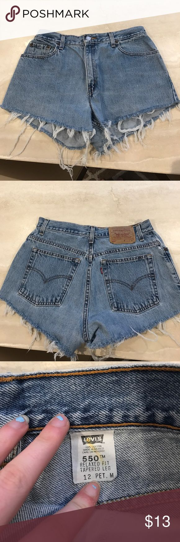 ADORABLE LEVIS HIGH RISE JEAN SHORTS High rise denim Jean shorts, silver button with zipper, fraying at bottom, pockets on back and in front Levi's Shorts
