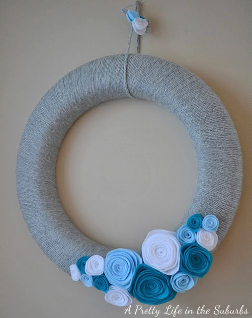 A Pretty Life in the Suburbs: My Winter Inspired Yarn & Rosette Wreath. I think this may be simple enough for me to try!